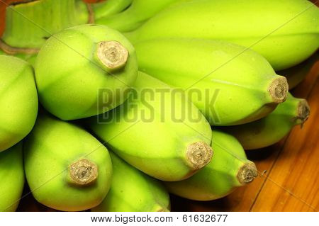 Green Banana On Wooden Table
