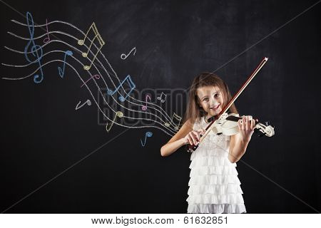 Female child playing the violin next to a blackboard