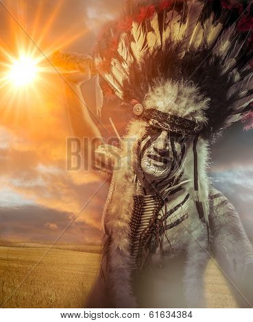 American Indian warrior, chief of the tribe. man with feather headdress and tomahawk