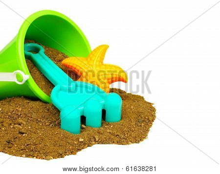 Beach toys and sand over white