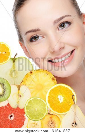 portrait of adult pretty woman with fruits