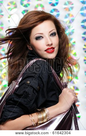Portrait of a beautiful modern girl holding shopping bag
