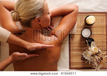 Woman getting  recreation massage in spa salon - high angle