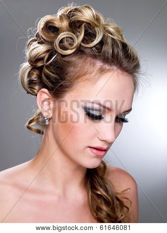 Beautiful young bride with blue make-up and ringlet wedding hairstyle