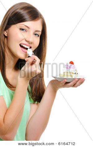 Beautiful Happy  Young Woman Eating Cake