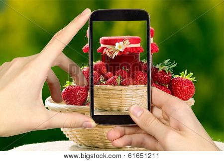Man Is Taking Photo Of Strawberries And Jar