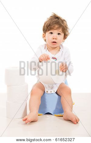 Amazed Boy Sitting On Potty