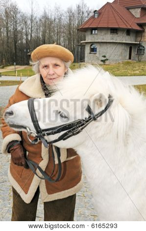 Happy Grandmother With White Pony