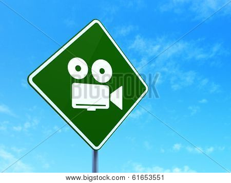 Travel concept: Camera on road sign background