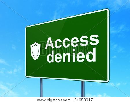 Privacy concept: Access Denied and Shield on road sign background