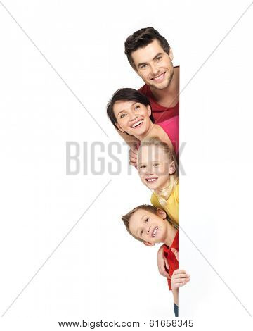 Family with a banner smiling - isolated on a white background