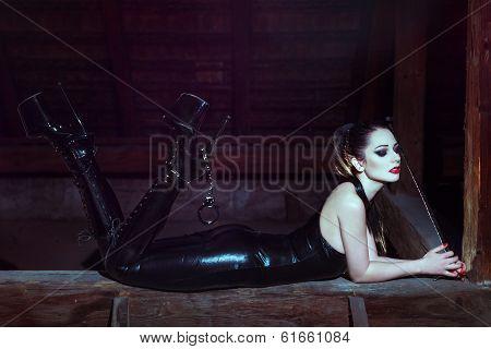 Sensual Woman Laying On Timber At Night
