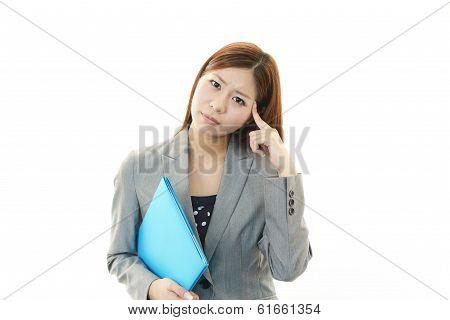 Portrait of business woman looking uneasy.