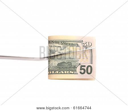 BBQ fork holds fifty dollar bill.