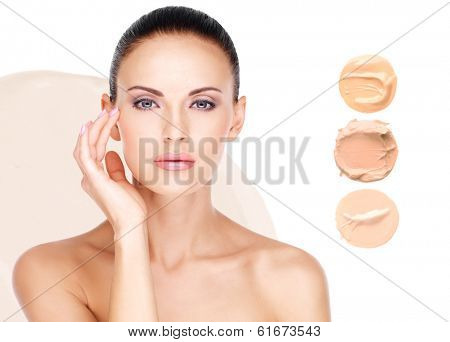 Model face of beautiful woman with foundation on skin make-up cosmetics .