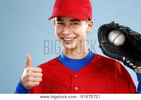 Portrait Of A Beautiful Teen Baseball Player In Red And White Uniform