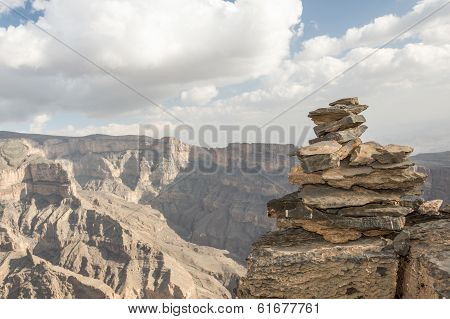 Pile of stones on the edge of a cliff