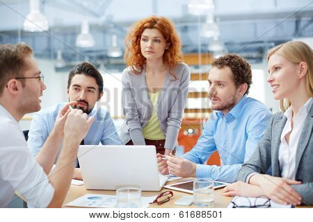 Business team listening to his leader with emphasis on a problem
