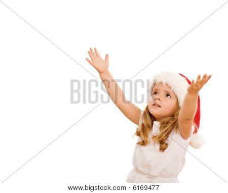 Niña, esperando la Navidad presenta a caída