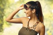 Summer portrait of sexy girl in sunglasses with pigtail.