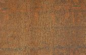stock photo of oxidation  - rusty metal texture showing various colours of metal oxidation - JPG