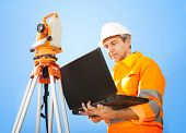 picture of theodolite  - Portrait of Senior land surveyor working with theodolite at construction site - JPG