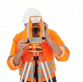 foto of theodolite  - Portrait of Senior land surveyor working with theodolite - JPG