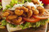 stock photo of shrimp  - Homemade Shrimp Po Boy Sandwich with French Fries - JPG