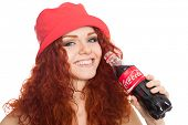 NAKHODKA, RUSSIA - MARCH 02, 2014: Beautiful girl holding a bottle of Coca-Cola. Coca-Cola is a very