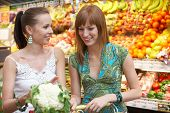 stock photo of grocery-shopping  - two friends while shopping - JPG