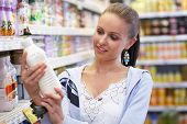 stock photo of grocery-shopping  - brunette beauty while shopping all brandmarks removed - JPG
