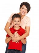 foto of pretty-boy  - Full portrait of a happy young mother with son 8 year old over white background - JPG