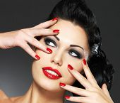 picture of nail-design  - Beautiful fashion woman with red nails - JPG