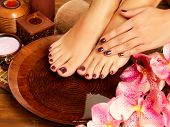 pic of legs feet  - Closeup photo of a female feet at spa salon on pedicure procedure - JPG