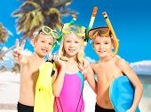 foto of flipper  - Portrait of the happy children enjoying at beach - JPG