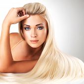 stock photo of blonde  - Beautiful woman with long straight blond hair - JPG
