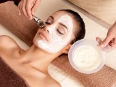 stock photo of facials  - Spa therapy for young woman having  facial mask at beauty salon  - JPG
