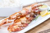 foto of tiger prawn  - Fresh fried Tiger Prawns on a spit