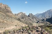 stock photo of jabal  - Panoramic view of a desert mountain landscape - JPG