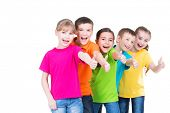 foto of gesture  - Group of happy kids with thumb up sign in colorful t - JPG