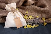 foto of sachets  - Textile sachet pouch with dried flowers - JPG