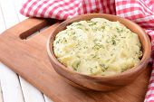 foto of mashed potatoes  - Delicious mashed potatoes with greens in bowl on table close - JPG