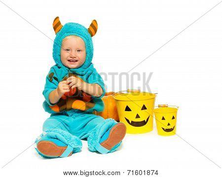 Little boy in horned Halloween monster costume