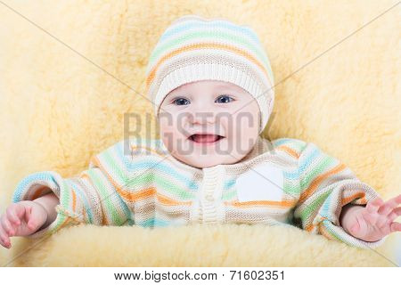 Little Baby In A Stroller Sitting In A Warm Sheep Skin Foot Muff