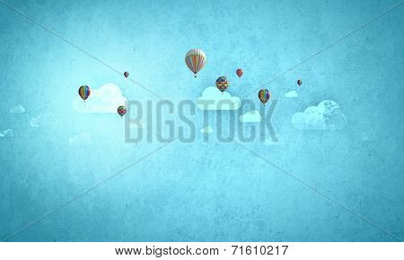 Colorful balloons flying high in blue sky