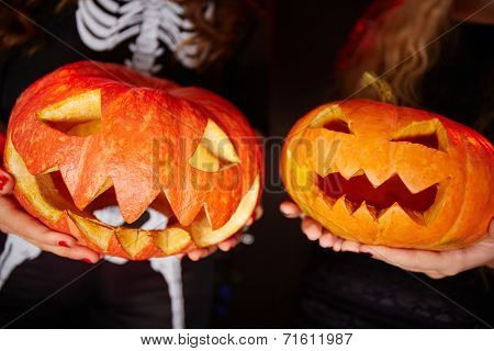 Two carved Halloween gourds
