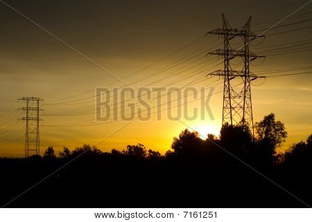 Electrical Power Transmission Tower At Sunrise.