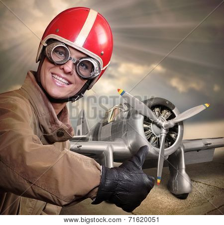 Happy pilot with retro fighter aircraft.