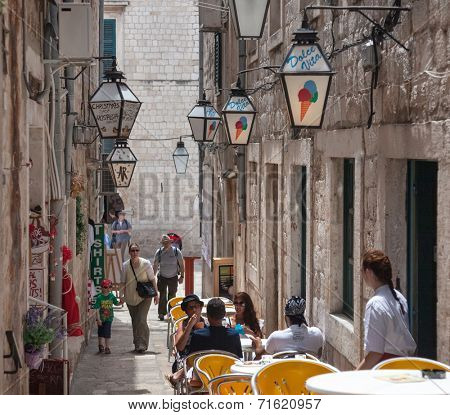 DUBROVNIK, CROATIA - MAY 27, 2014: Tourists sitting on terrace of Dolce Vita, one of the most popular ice cream place in Dubrovnik.
