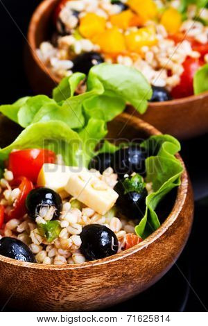 Wood Bowl With Spelt Salad With Olives And Tomatoes